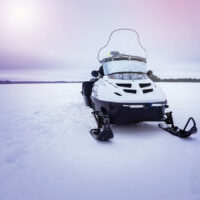 snowmobile on a winter lake, a place for the text.